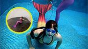 巴西女孩并腿在水下游走
